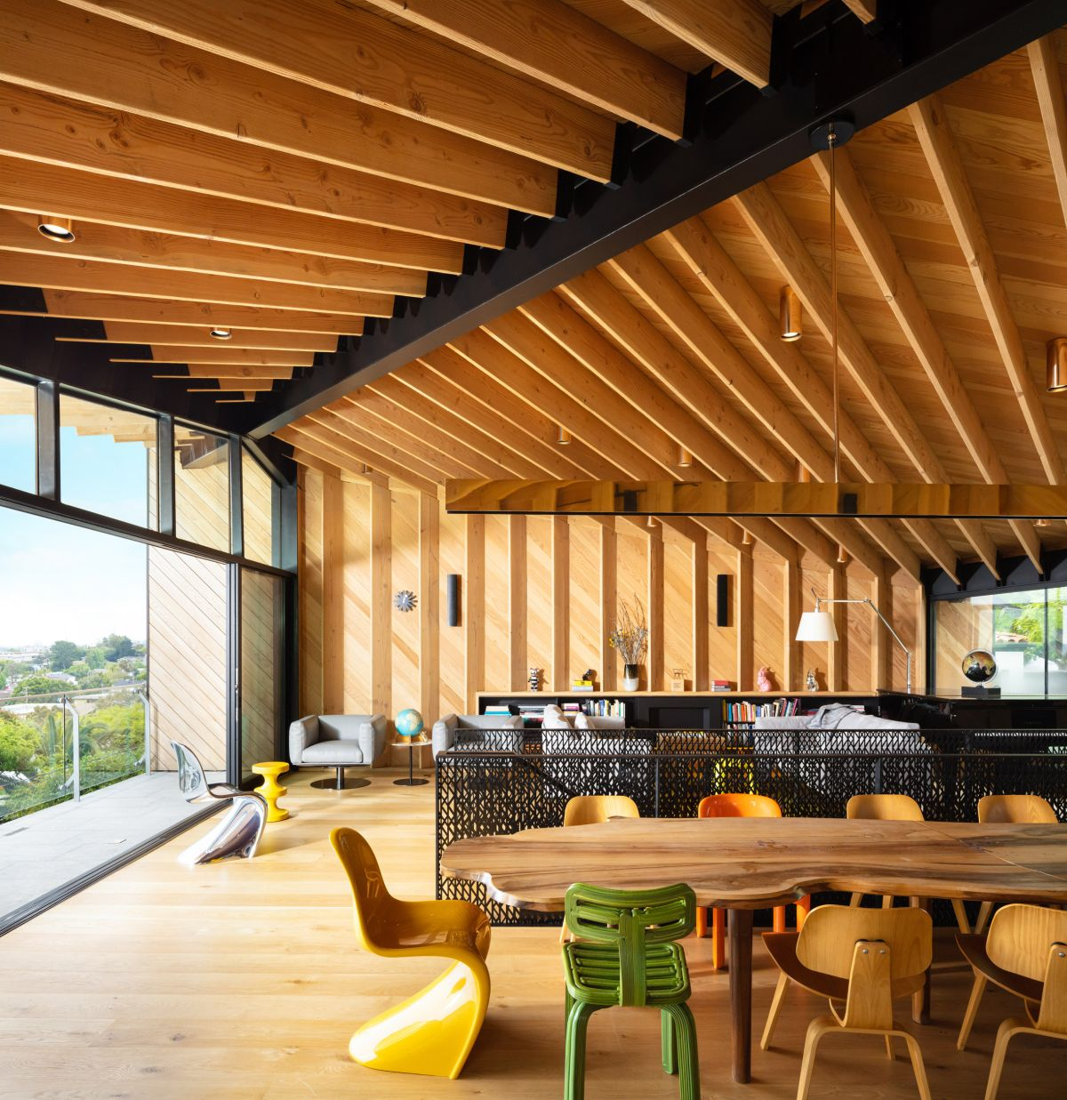 Wooden beams cover the walls and ceilings on the top floor, creating a very warm and inviting environment