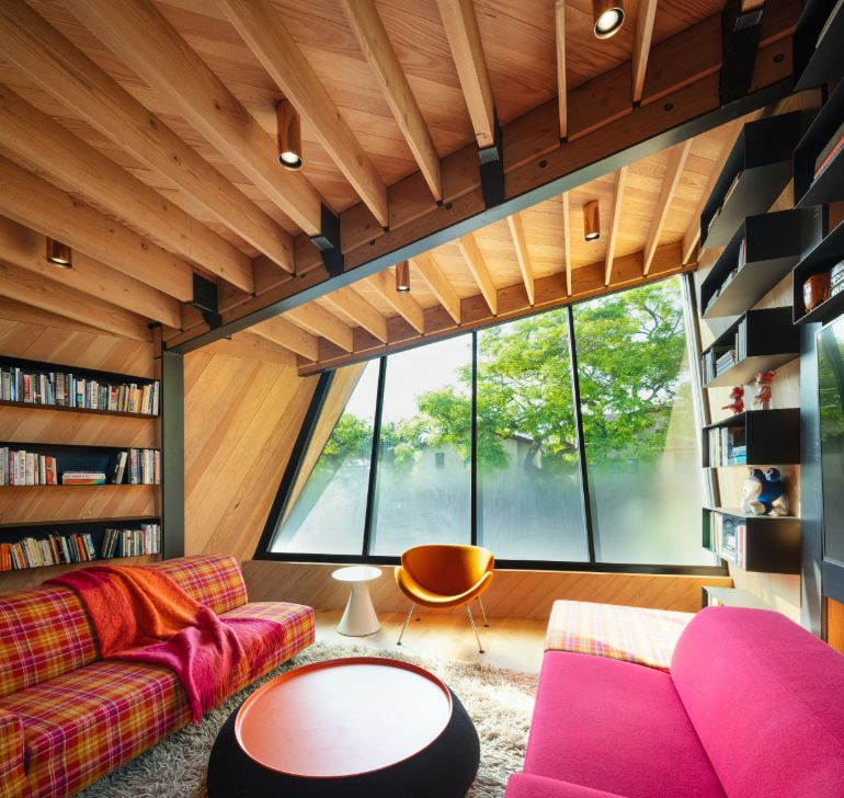 The attic-like top floor has an unusual geometry which gives some of a spaces asymmetrical layouts