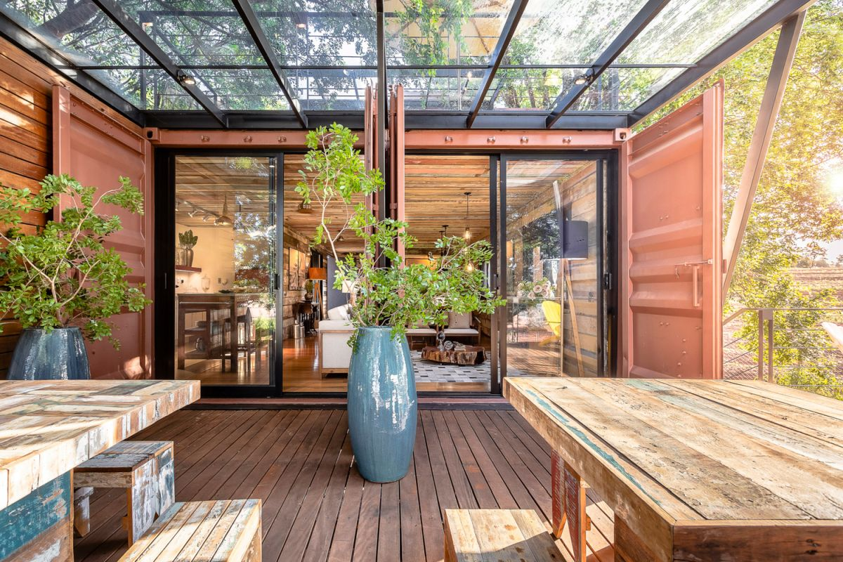 The house is made out of a series of recycled shipping containers which have been connected and customized