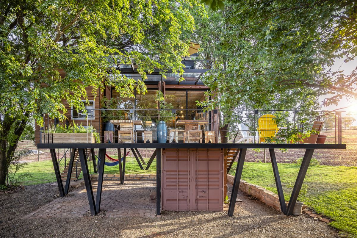 Beautiful Shipping Container House Raised Among The Tree Canopies