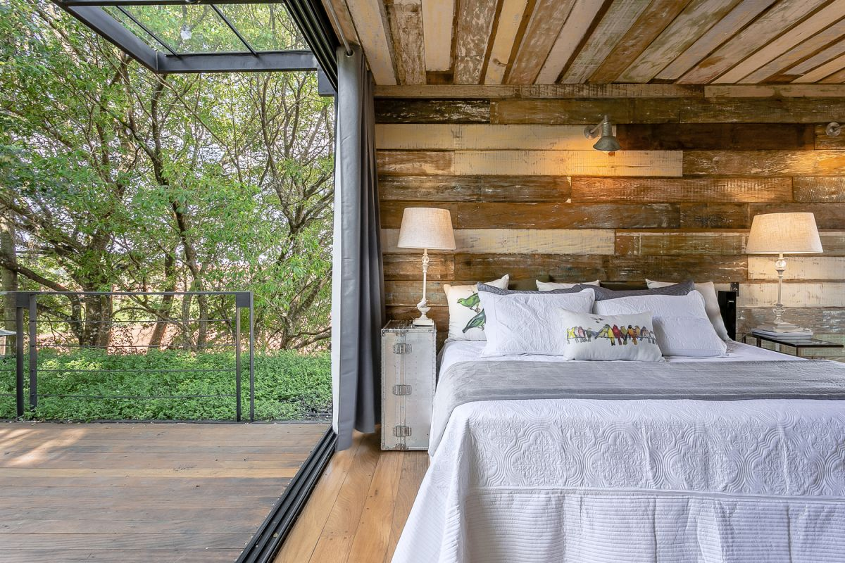 The sliding glass doors give this bedroom direct access to a terrace with a beautiful view over the surroundings