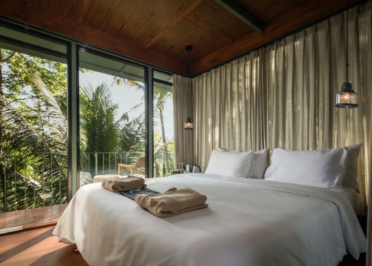 The suites are chic and welcoming and have balconies and glass walls which bring in the tropical beauty which surrounds them