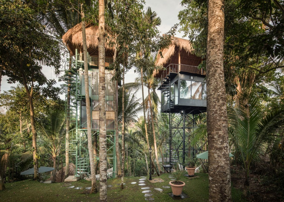 This experimental boutique hotel is organized into several small structures raised up in the air among the treetops
