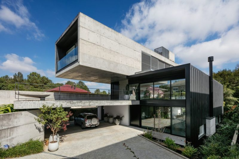 A Three-Story Concrete House Hidden Among The Trees