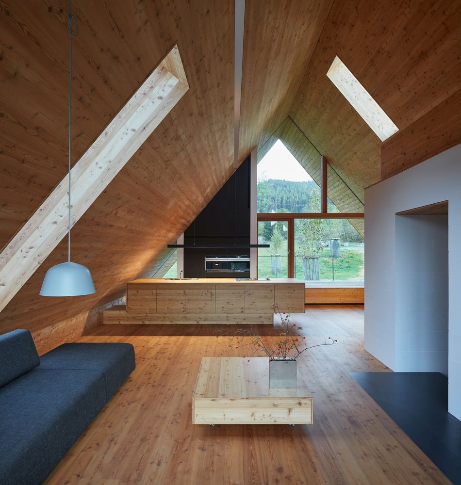 The top floor is a very cozy attic with skylights and wood-paneled walls and floors