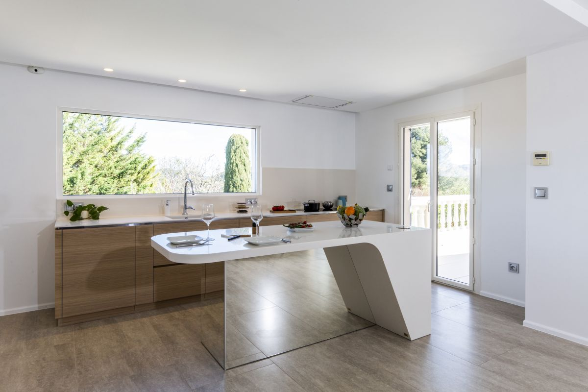The kitchen island is the focal point of this area and a visual divider between the cooking space and the living room