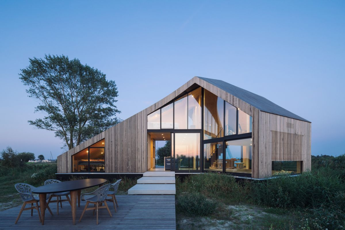 Large windows allow lots of natural sunlight inside the house and also bring the outdoors in