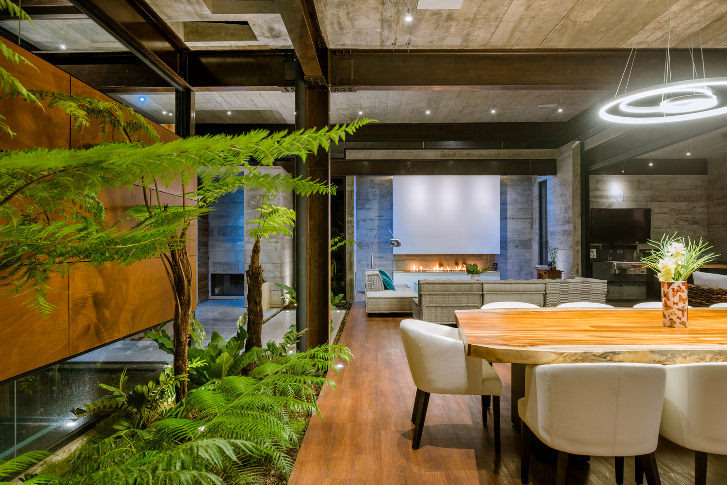 The beautiful lush garden also manages to actively become a part of the interior design