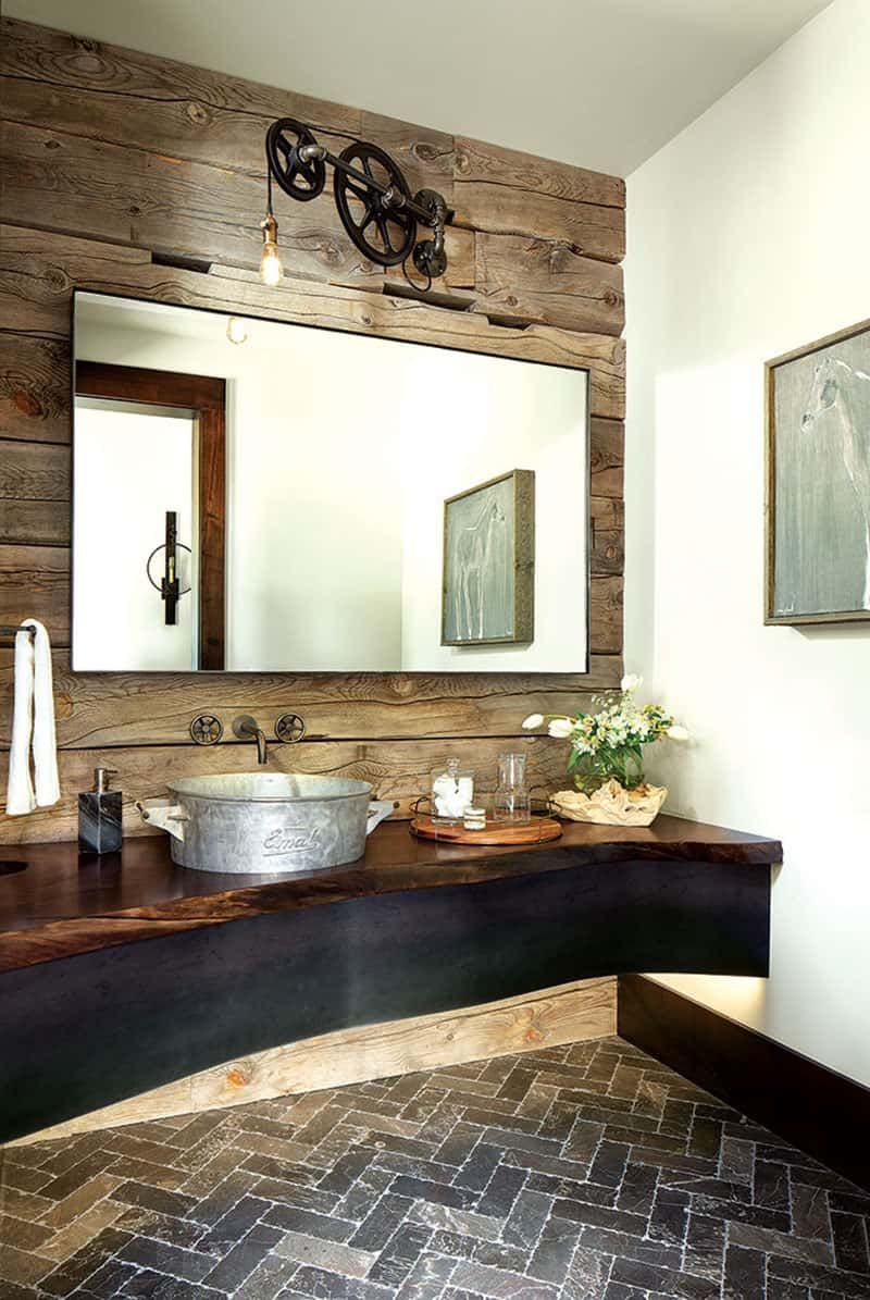 A live-edge wooden counter gives this bathroom a really cool look and suits the rustic aesthetic of the house