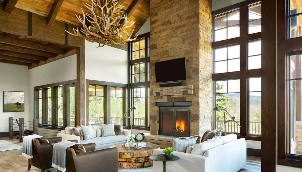 The living area is marked by a full-height stone fireplace surround