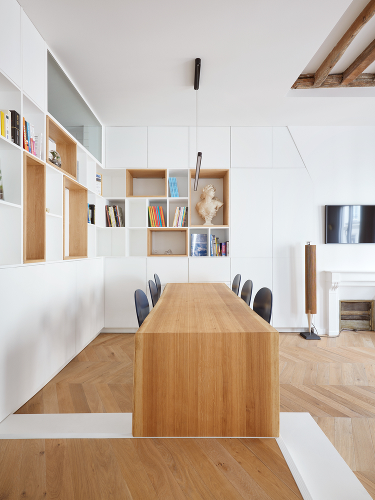 White is the background color used throughout the apartment, complemented by natural wood