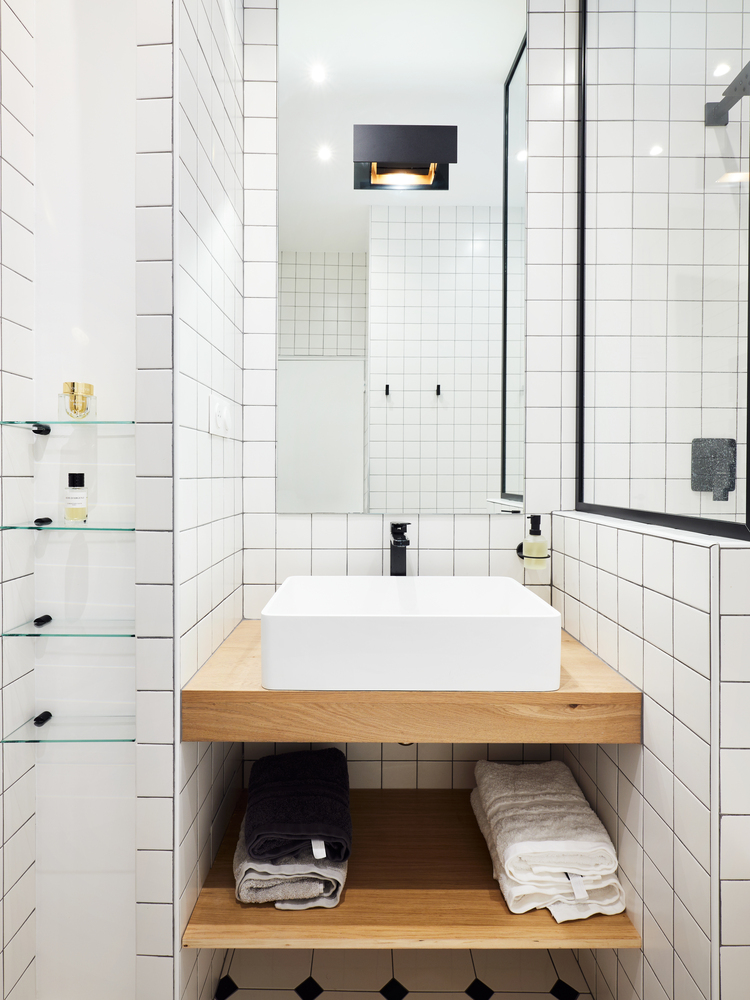 Wall mirrors were added to the bathroom as a way to make it look larger