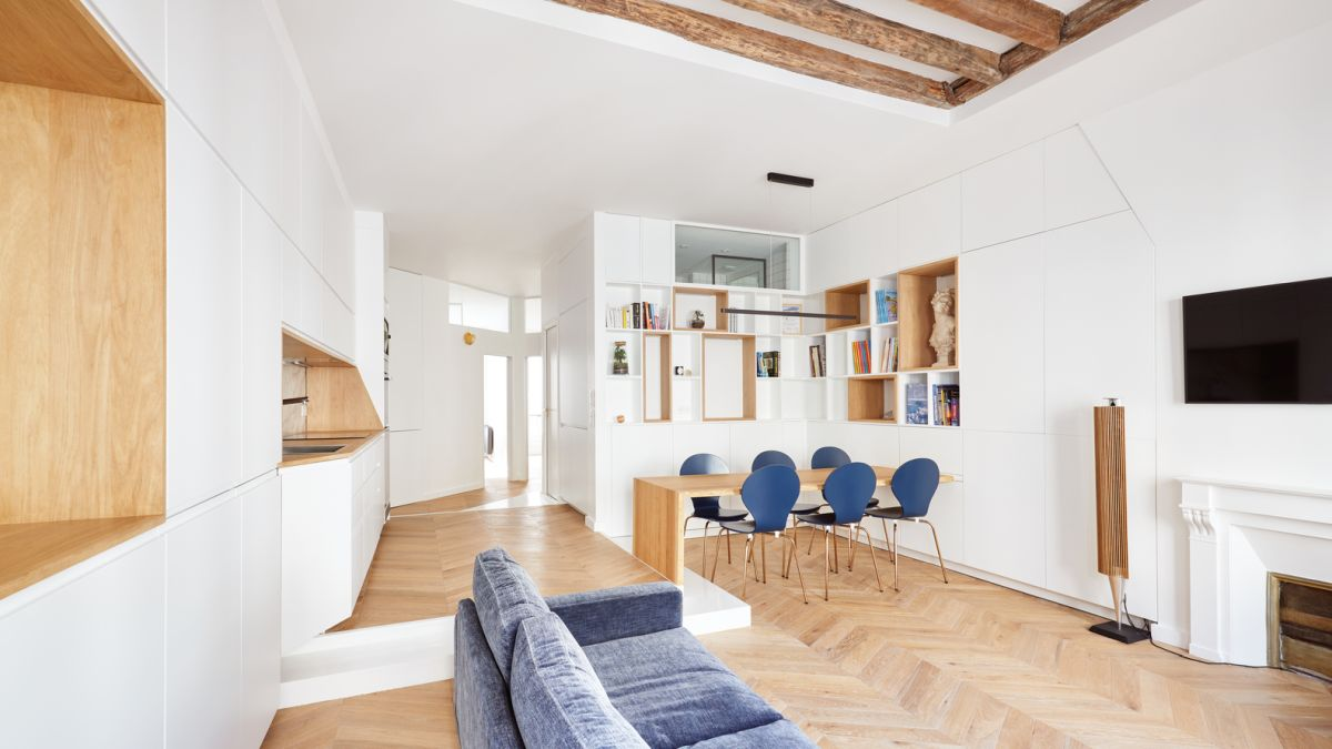 Blue is the accent color of the apartment, strategically added to some of the rooms
