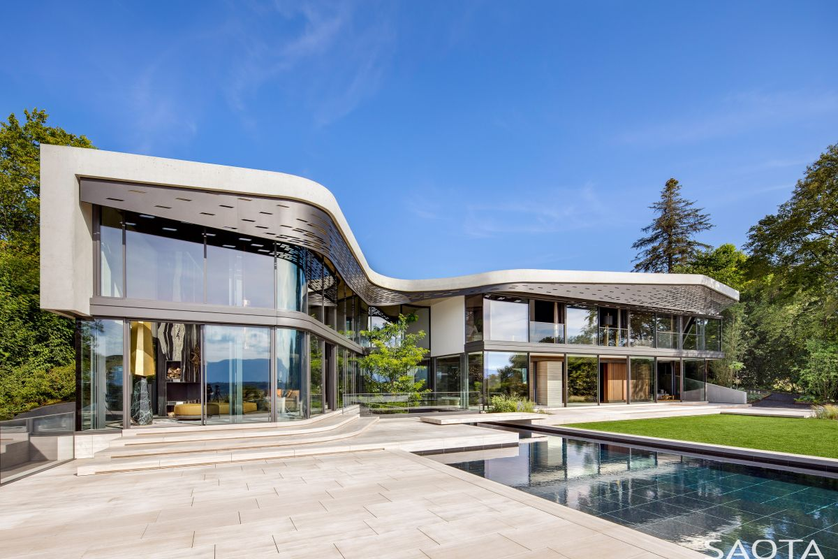 A Stunning Villa With A Curved Roofline Inspired By The Beautiful Surroundings