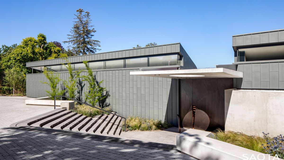 The zinc cladding is designed to offer lots of privacy while the clerestory windows allow natural light to enter the house