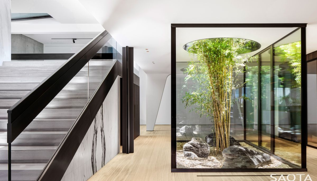 Nature is invited inside the house in the form of green areas such as this one