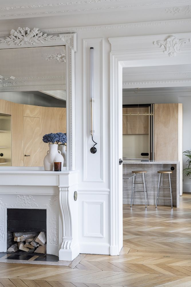 The ceiling and wall moldings that keep the historic beauty of the apartment alive along with other details