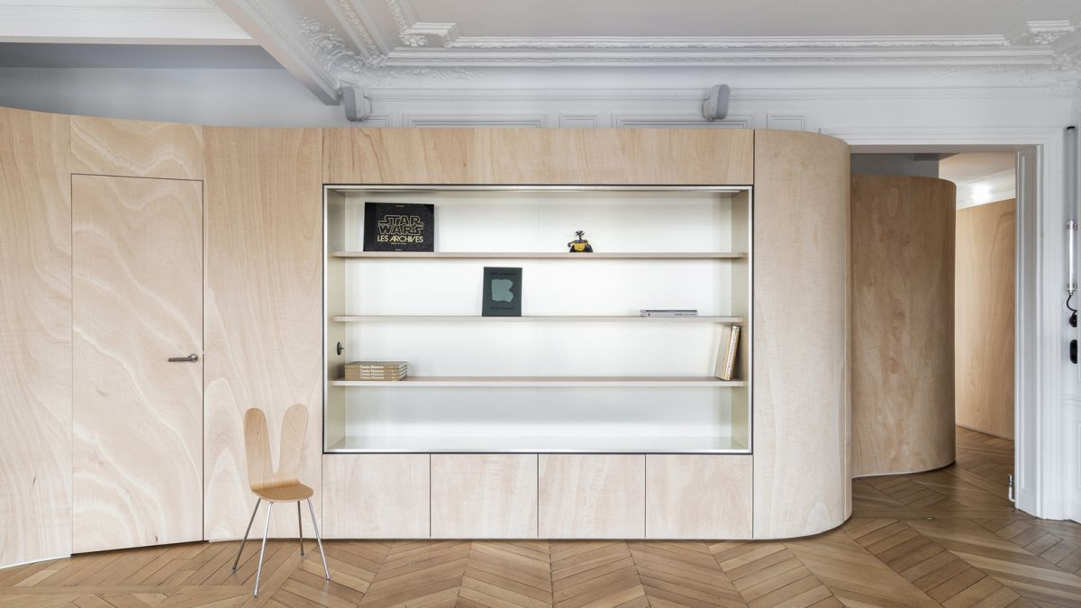 The ribbon wall is multifunctional and also includes some storage for various areas