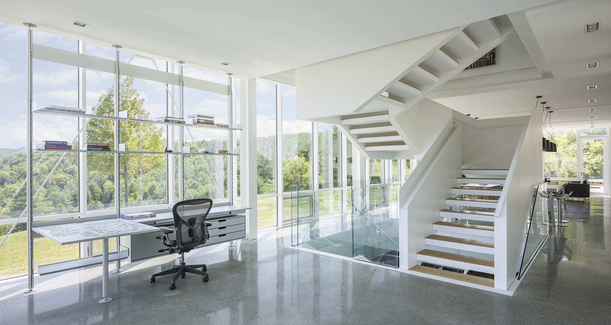The staircase which connects all the floors sits at the venter of the house and has a very sculptural design
