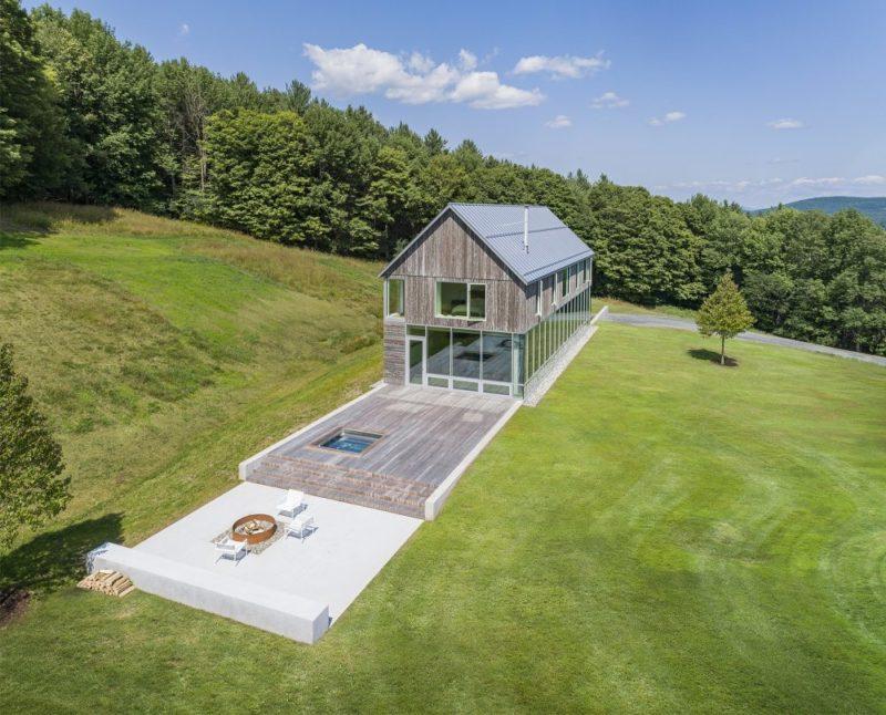 Modern Barn House Built Into a Hillside Meadow