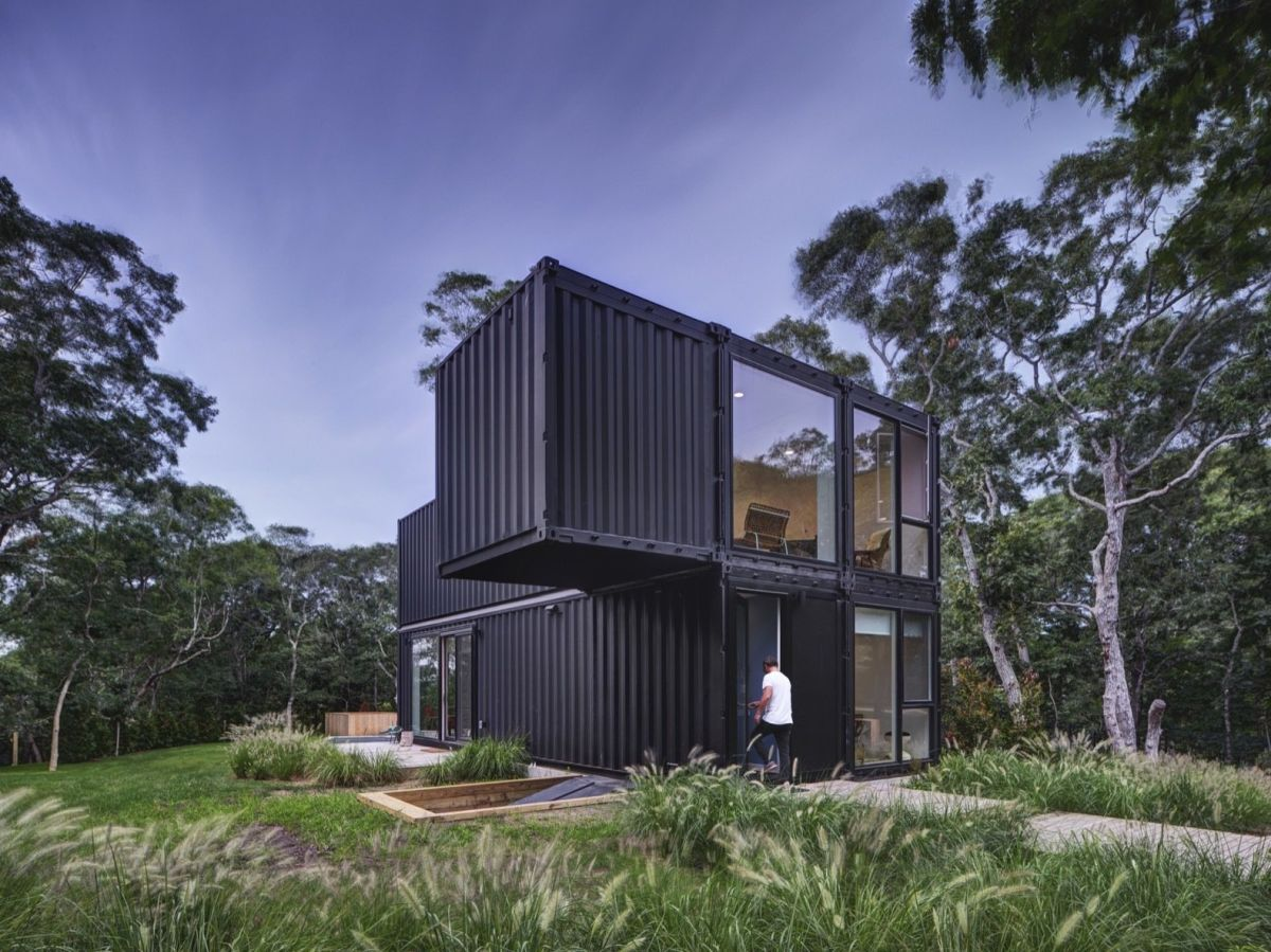 The house has a simple geometry with only one small container extending over the side