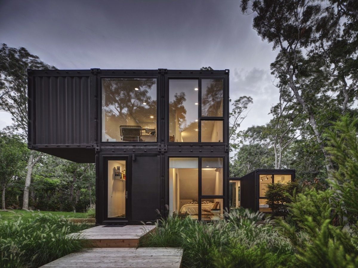 One of the containers forms a cantilevered volume on the top floor, making the most of the views