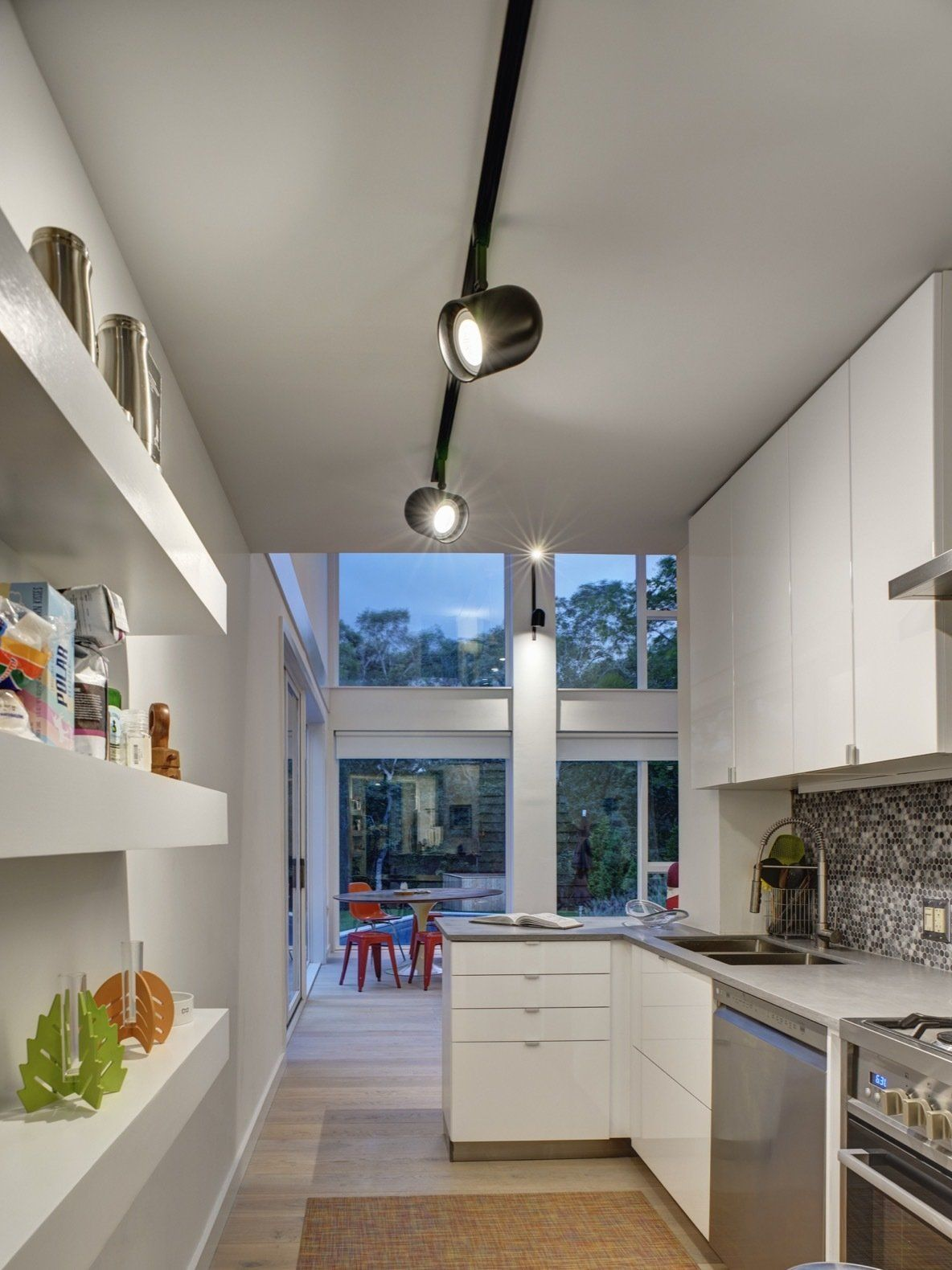 The kitchen opens onto the main living area but acts as a separate space