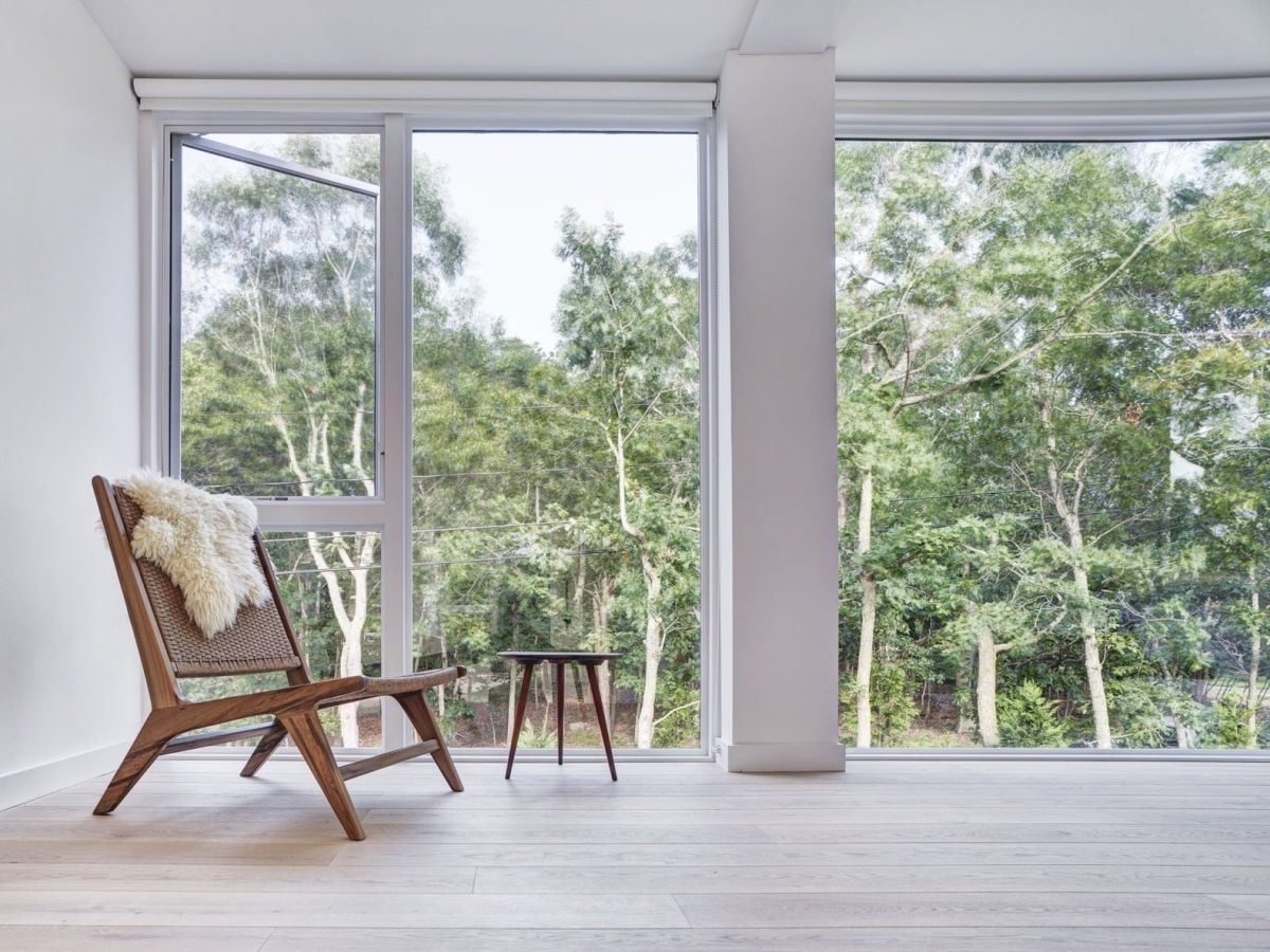 The large windows let in lots of light but also frame beautiful views of the surrounding landscape