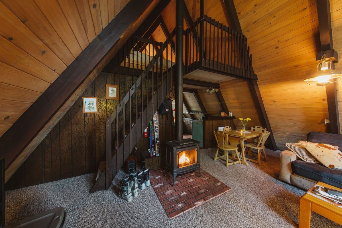 There's a fireplace inside which sits in front of the staircase, at the center
