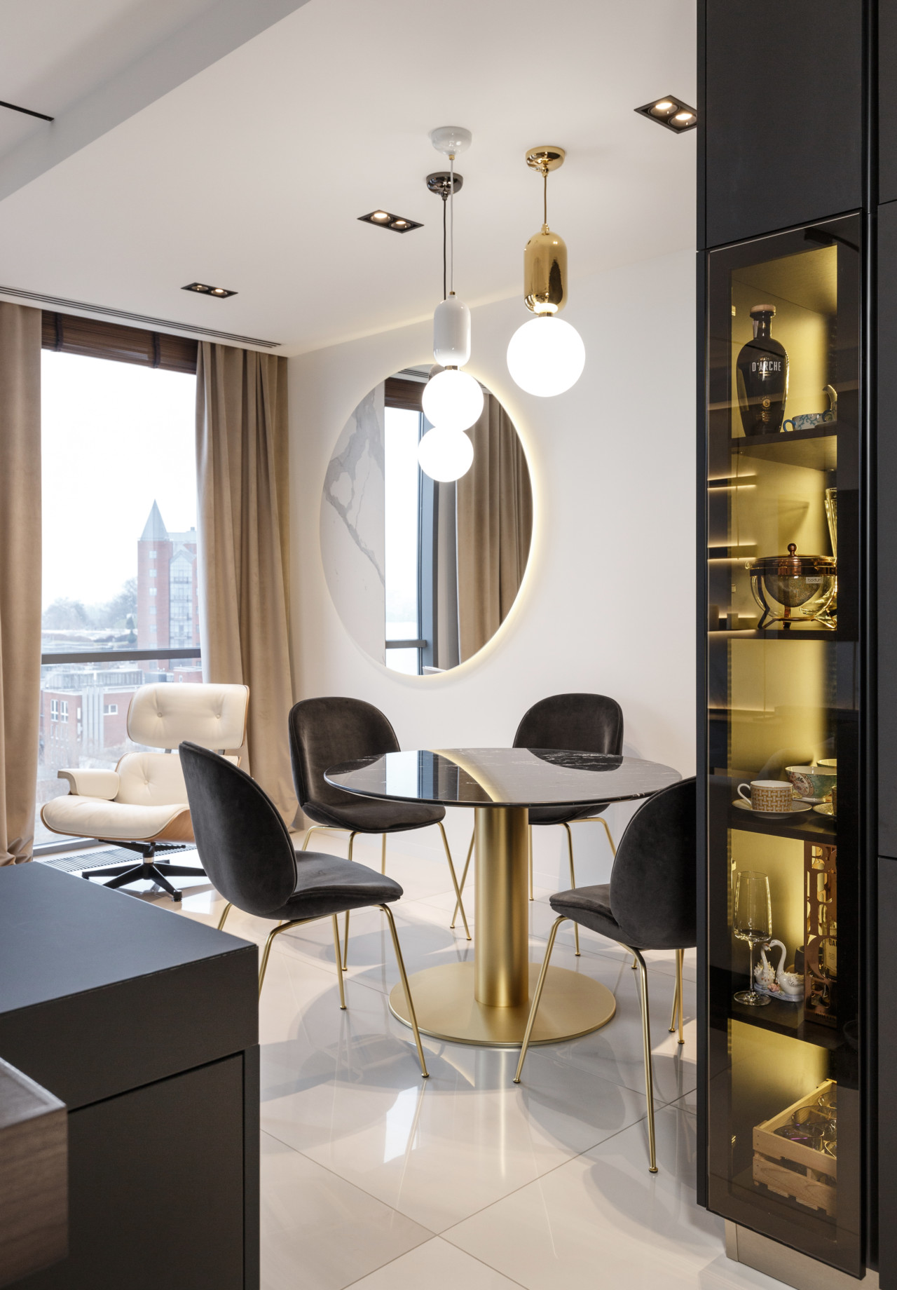 The dining table is very sleek and elegant, featuring a circular pedestal base and a round top