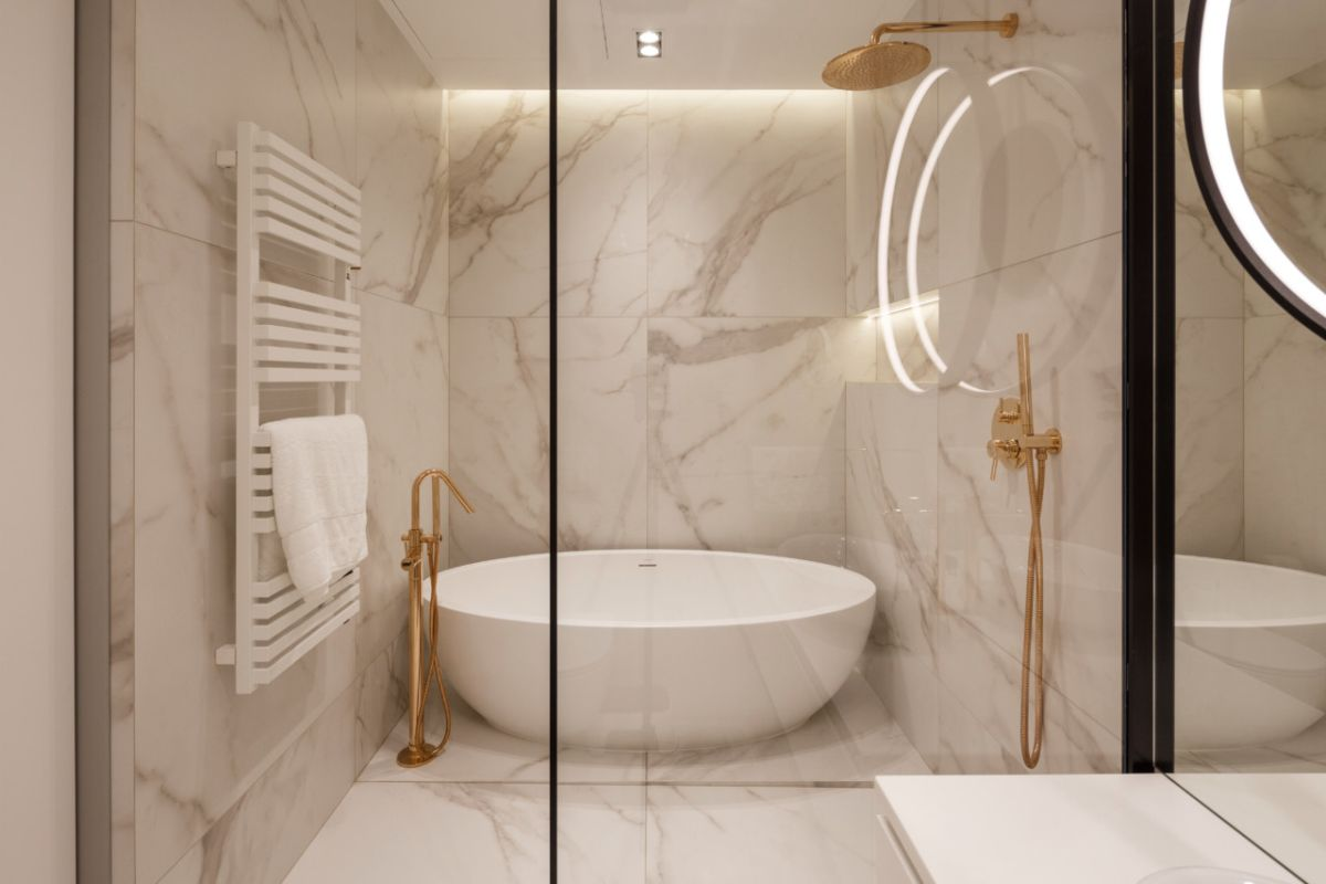 The master bathroom makes extensive use of marble and has an elegant walk-in shower and tub combo
