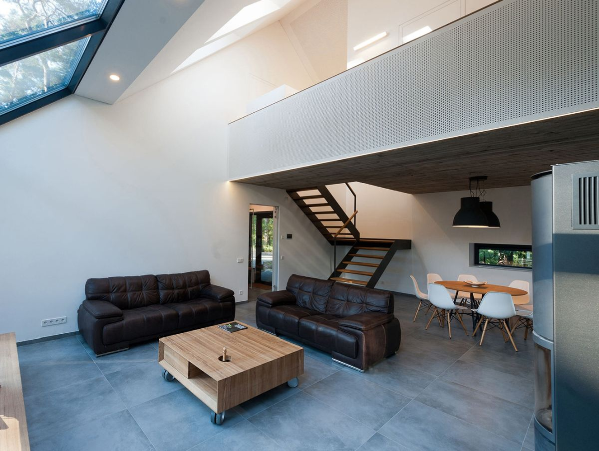The glazed walls continue onto the roof which lets in lots of natural lighting