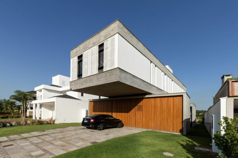 Modern-Industrial House With A Cantilevered Concrete Volume