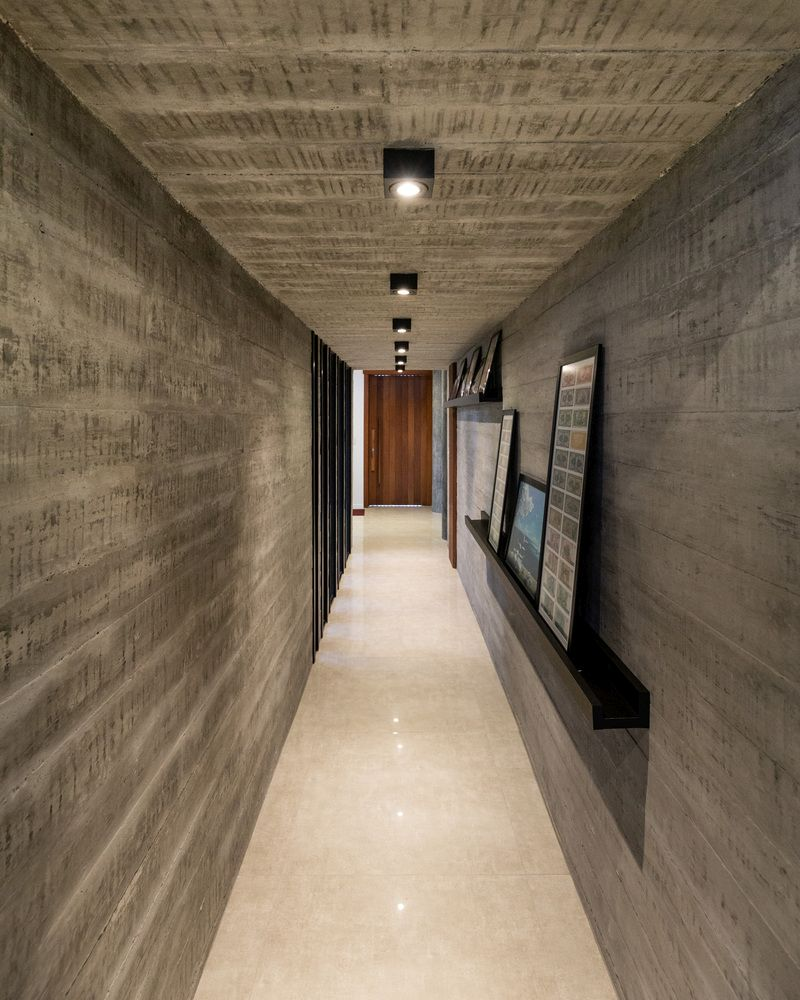 The unfinished concrete surfaces add a strong industrial twist to the overall design of the house