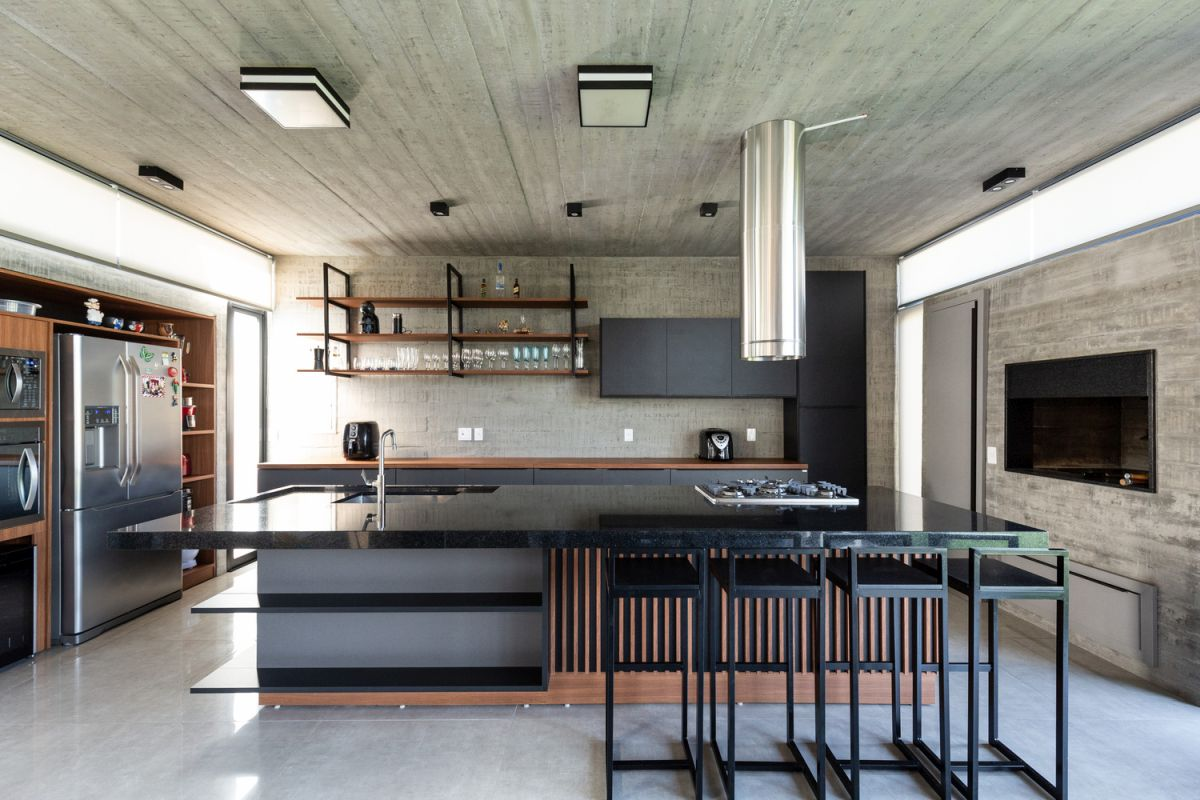 The kitchen island features an interesting design with an unusual geometry