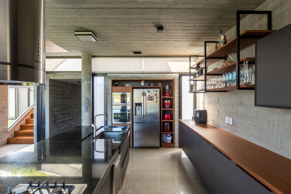 The kitchen is large and spacious and has a modern-industrial design