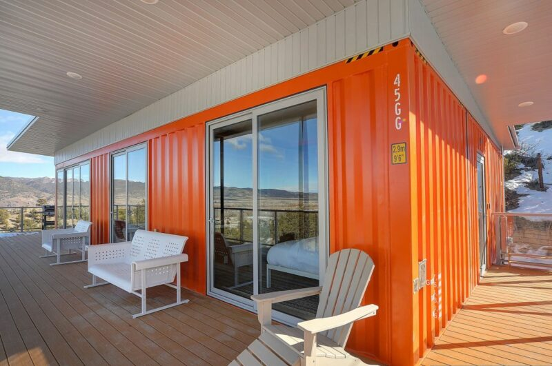 A Mid-Century Modern Shipping Container Home With A Bright Orange Exterior