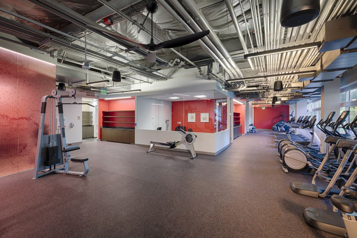 The fitness center maintains a slightly rugged look but also feel warm and inviting
