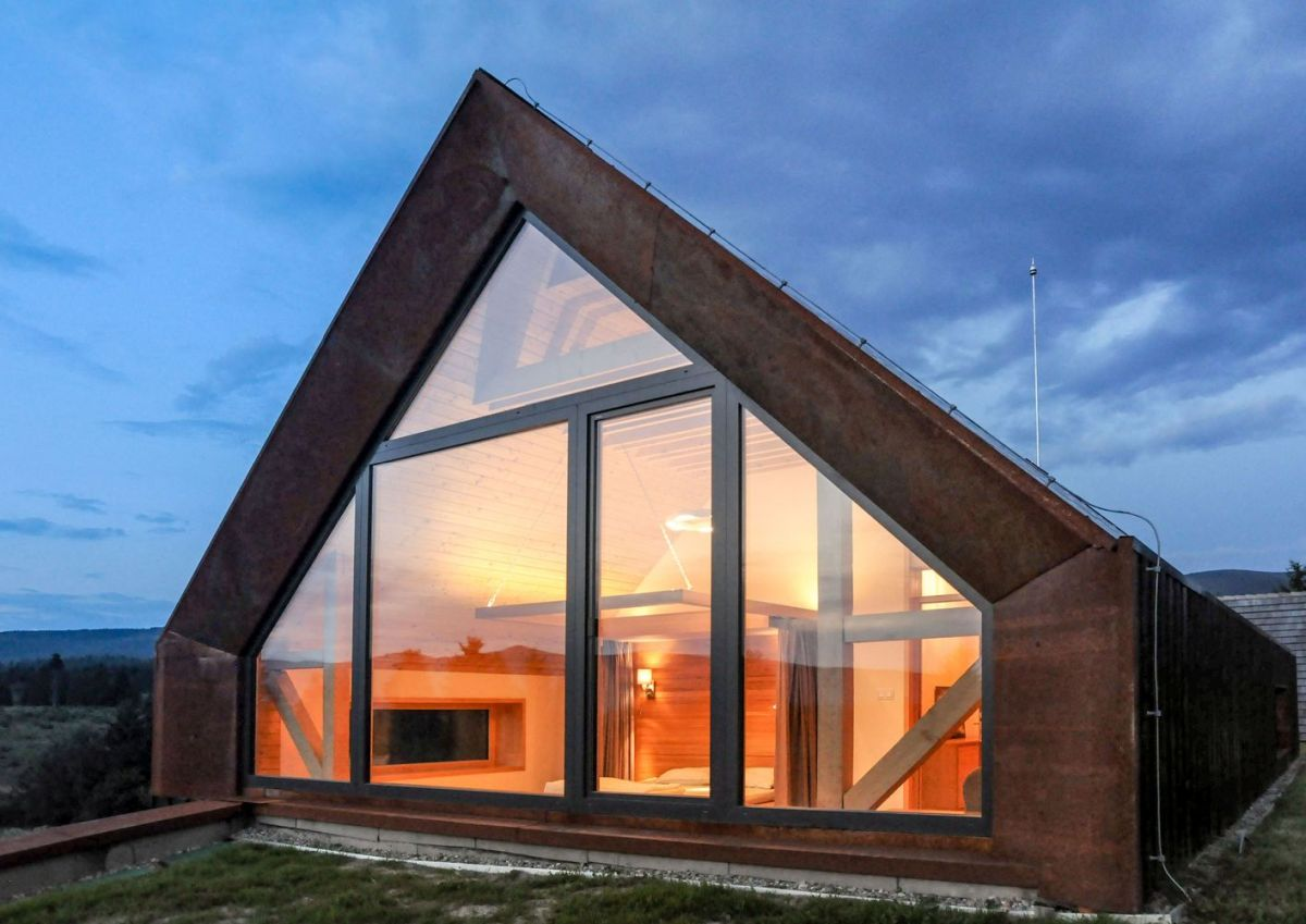 Large glazed sections open up the interior to the beautiful mountain scenery