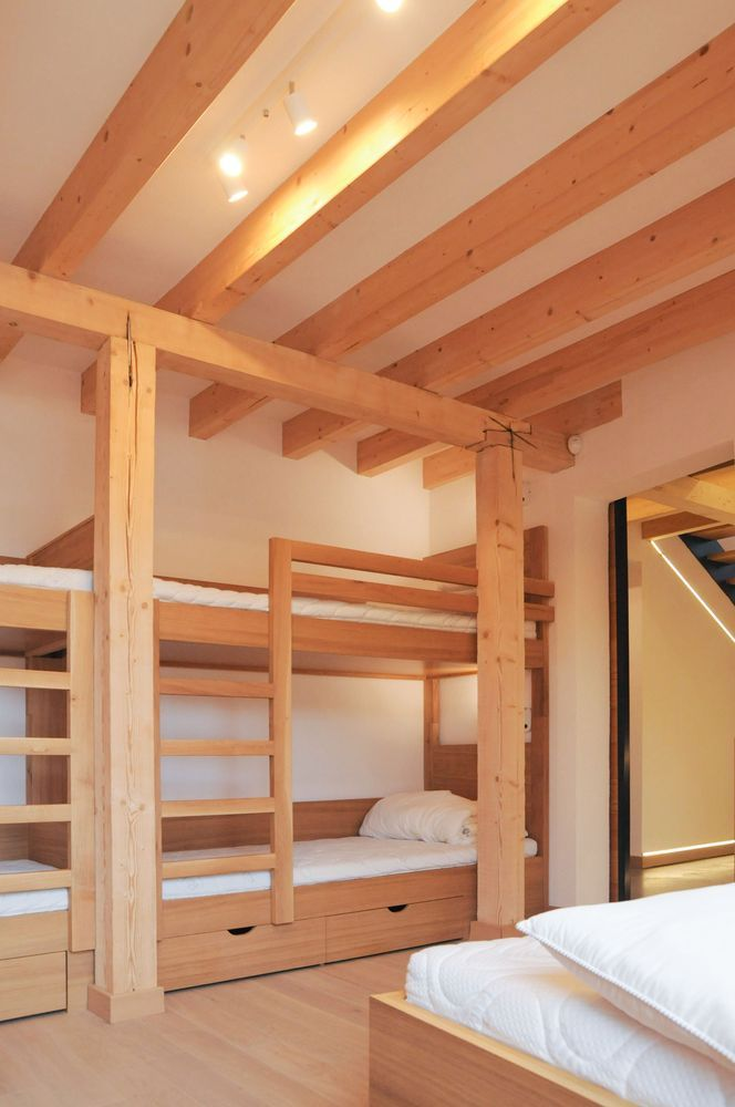 The house is designed to accommodate a large family and friends and includes a cozy guest room with bunk beds