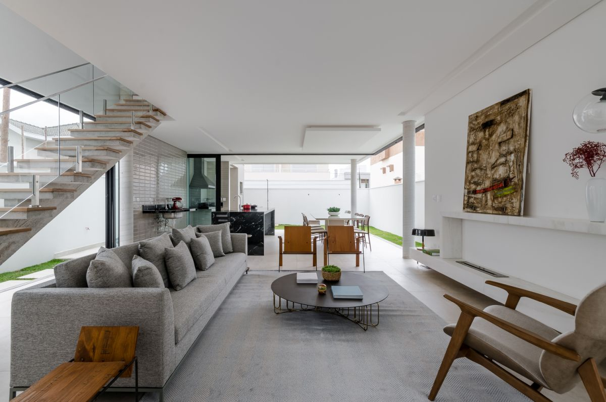 The ground floor houses all the common areas such as the kitchen, the dining room and the living area