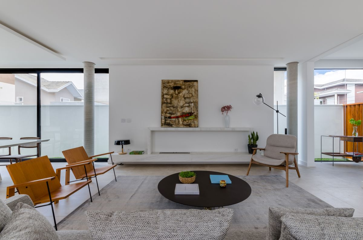 The white walls and ceiling create a very open and bright decor throughout this entire volume