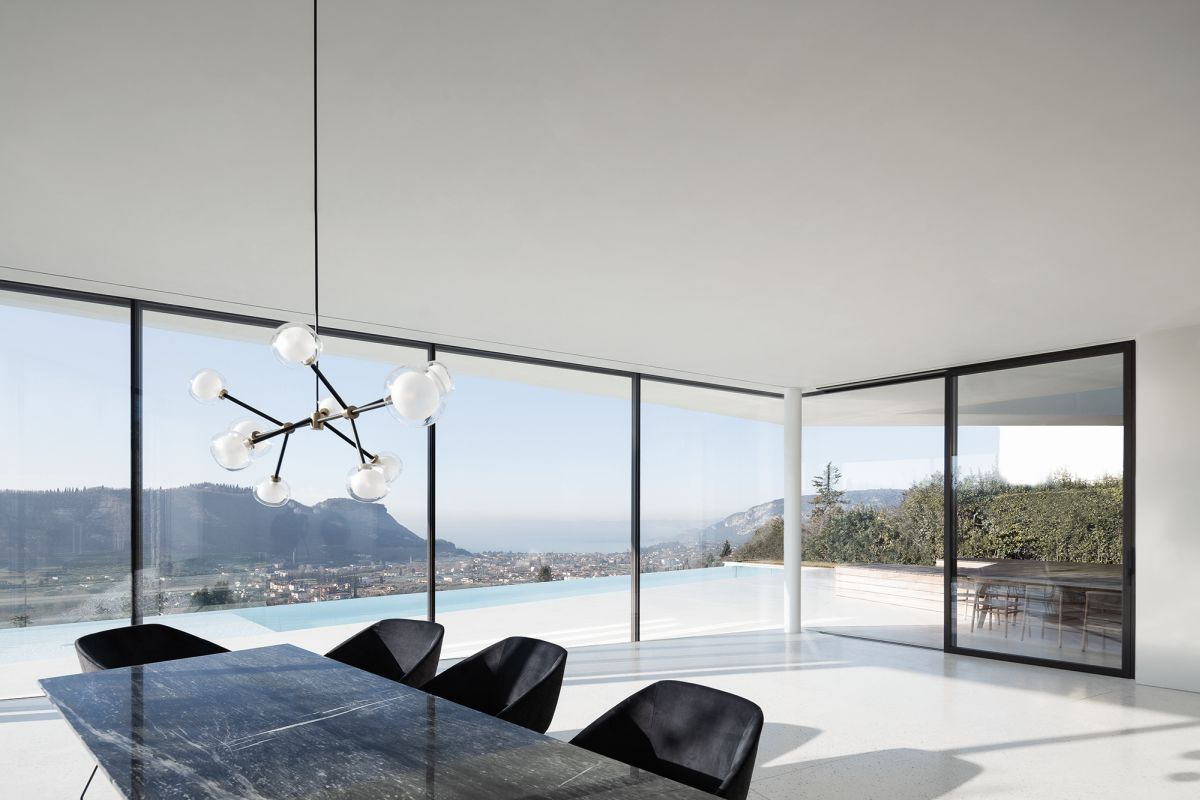 The full-height windows on both floors frame the panoramic views over the valley