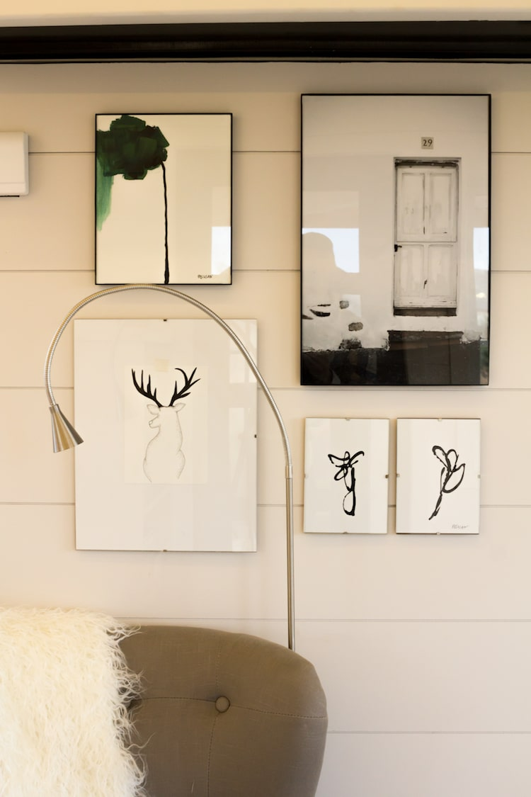 Beautiful modern artwork is displayed on the walls throughout this tiny home