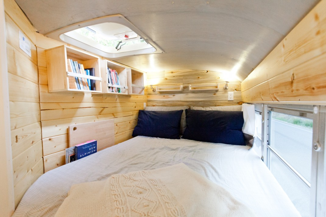 At the very end of the bus there's a loft bedroom with a comfy bed and some storage