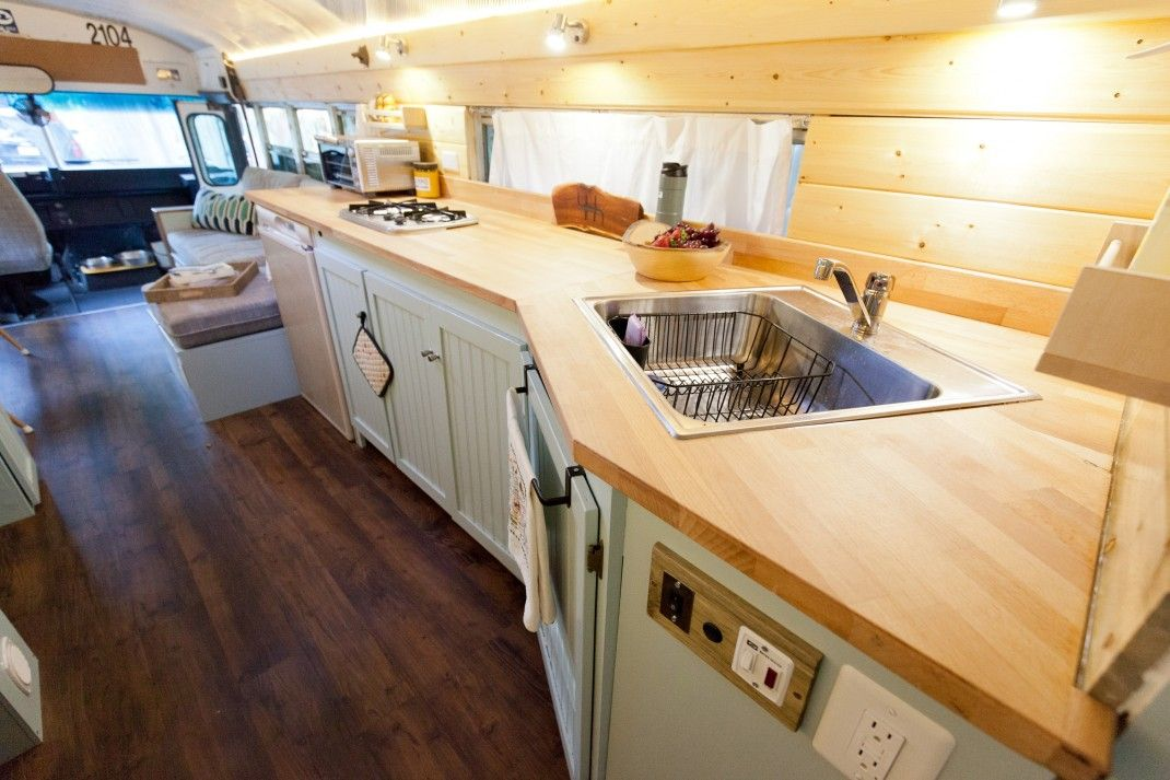 There's a sink, a fridge, a stove and plenty of storage in the kitchen