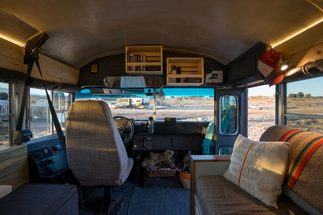 The driver's seat is the original one that came with the bus, with a new cover