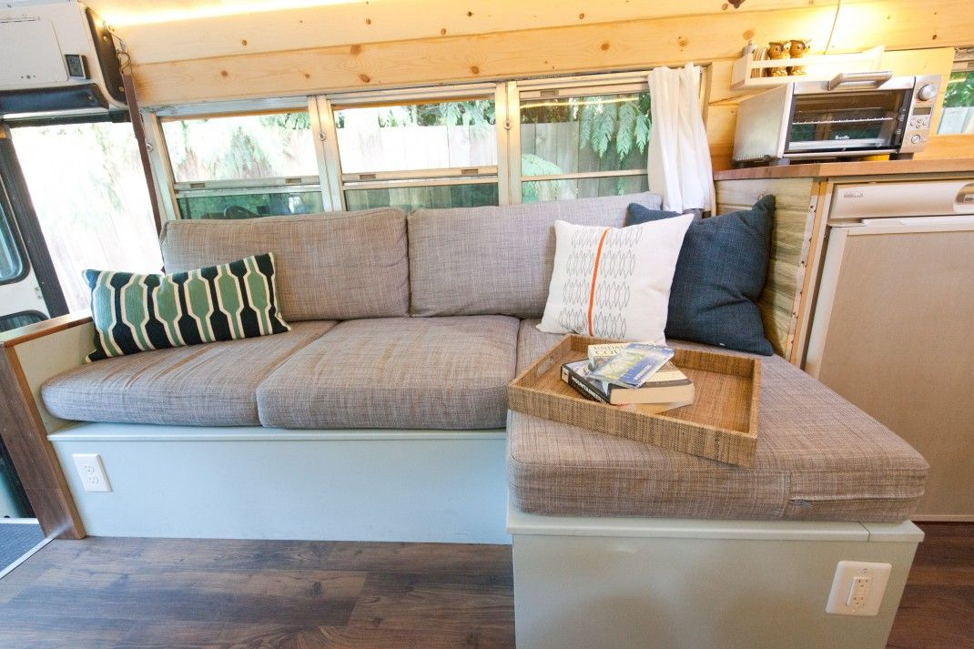 The couch is actually L-shaped and differentiates the living area from the kitchen