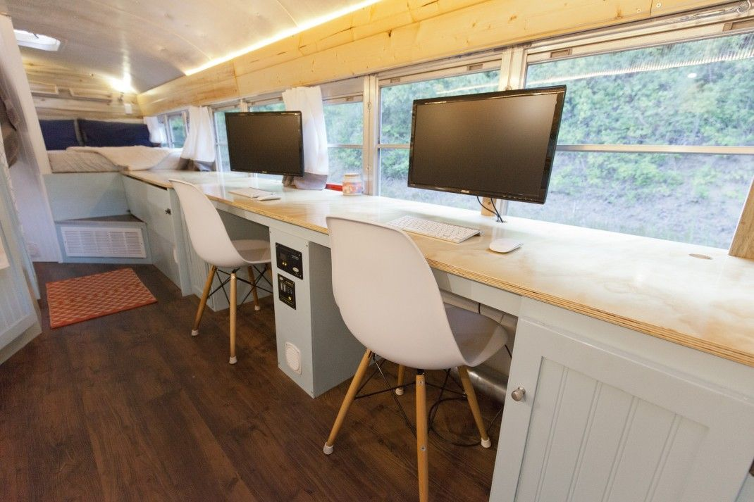 The area opposite to the kitchen serves as a home office, allowing the owners to maintain a career while traveling the world