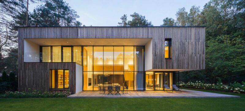 Modern House With Glass Doors And A Display Garage